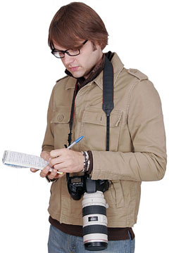 journalist with notepad and camera